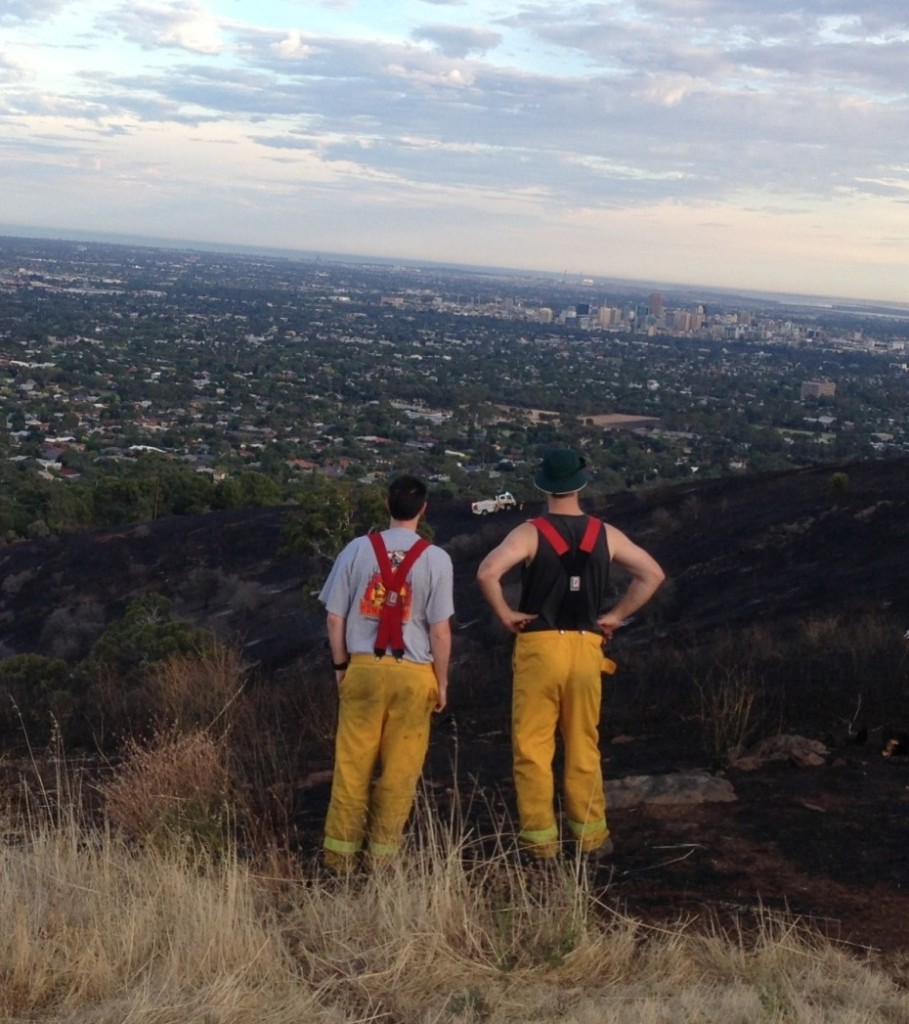 Fire fighters stand watch over blacked out area
