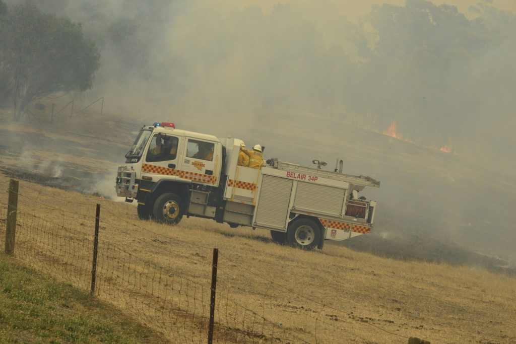 Belair 34P pumps and rolls to contain a running grass fire at the Sampson Flat Fire (Photo Ashley Hosking - CFS promotions unit)